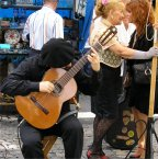 Guitar playing for street tango
